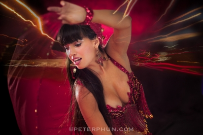 Melinda in red belly dancing outfit