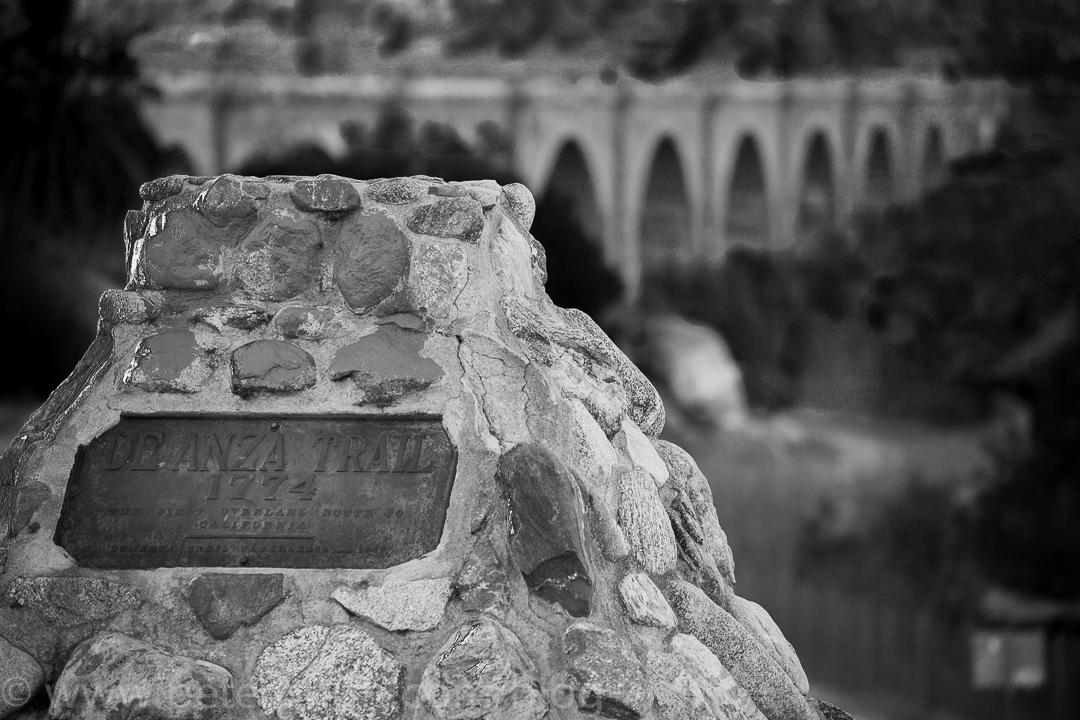 The Deanza trail marker overlooks a railroad bridge which crosses the Santa Ana river.